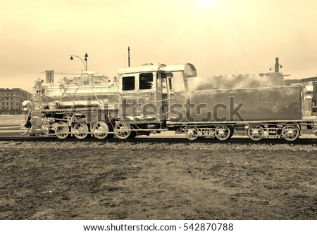 Old silver locomotive wrapped in aluminum foil -  in retro style