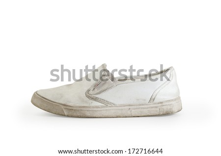old  sneakers on a white background, isolated - stock photo