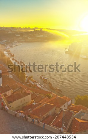 old town of Porto with river Douro at sunset, Portugal - stock photo