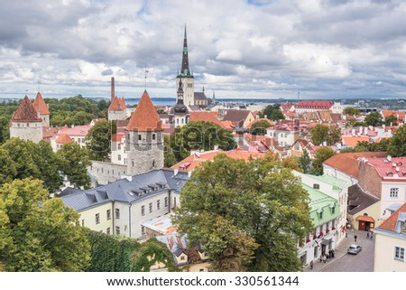 Old Town of Tallinn, Estonia-September 30, 2015: Old City view from Toompea upper town hill with St. Olaf's church spire, medieval defense towers, fortification walls and historical buildings.