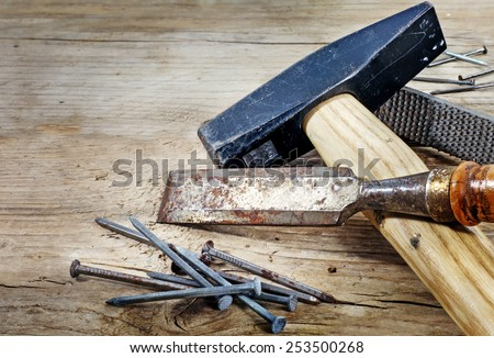 old wood worker tools on a rustic wooden board, copy space in the background - stock photo