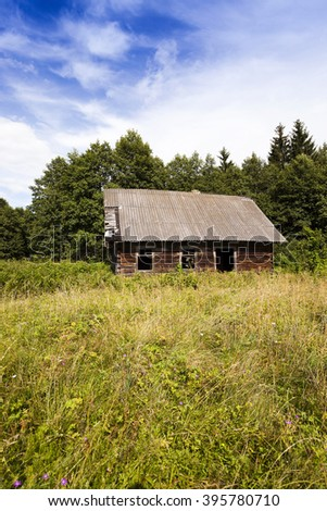 old wooden abandoned house.It located in the countryside. Belarus. - stock photo