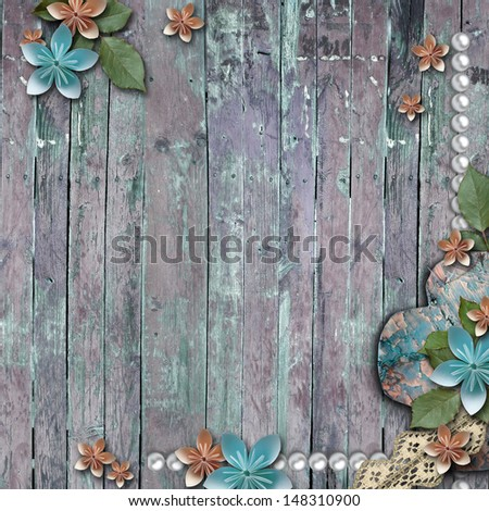 Old wooden background with a  flowers, pearls and lace  - stock photo