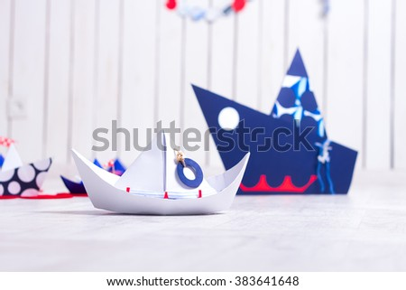 Ð¡olorful paper boats on the wooden floor - stock photo