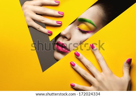 ?oloured paper and a beautiful girl's face  - stock photo