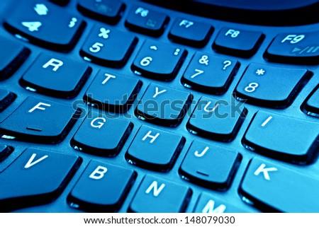 ��¡omputer keyboard in blue light. Pincushion lens use. - stock photo