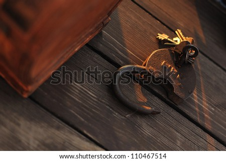 on a timber floor the old lock with keys lies - stock photo