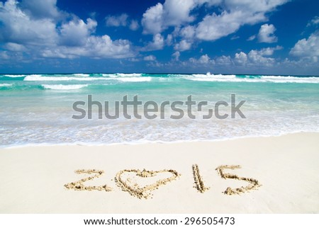 2015 on beach - concept holiday background