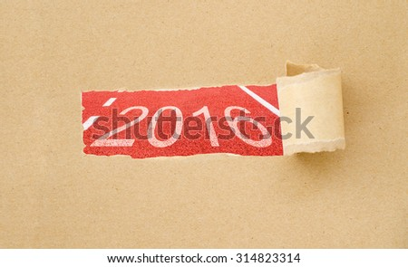 2016 on red racing track with Brown Torn Paper. 2016 concept. - stock photo