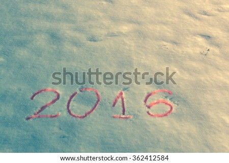2016 on the snow for the new year and Christmas. Vintage filter applied. - stock photo