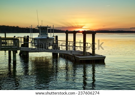 """""""On the Waterfront"""" A December sunset on the Colleton River tidal estuary near Hilton Head Island in Beaufort County, SC. - stock photo"""