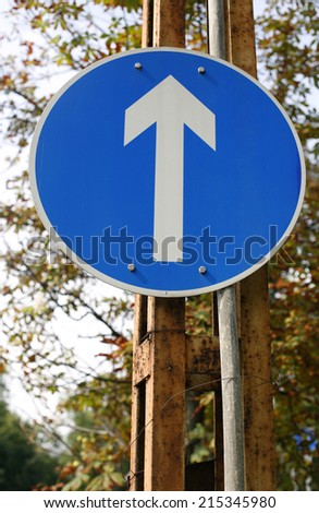 One direction. Traffic signs warning signs and traffic lines - stock photo