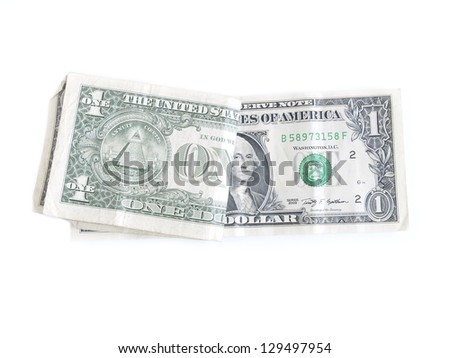 one dollar bills folded in half isolated on white background.