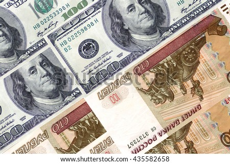 100 (one hundred ) dollars ?nd 100 ( one hundred  ) rubles . - stock photo