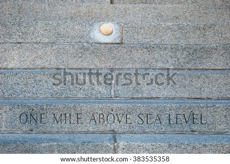 """""""One mile above sea level"""" - inscription engraved on the fifteenth step of the west entrance to the historic Colorado State Capitol Building in Denver. - stock photo"""