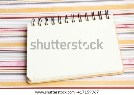 Open notebook on desk, on table, can be used for your text or artwork, Top view business concept. mockup, note, texture. place for text. Top view, flat lay with copyspace for slogan or text message.
