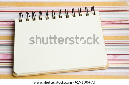 Open notebook on desk, on wooden table, can be used for your text or artwork, Top view business concept