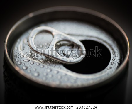 Opened aluminum can with water drops. Selective focus with shallow depth of field. - stock photo