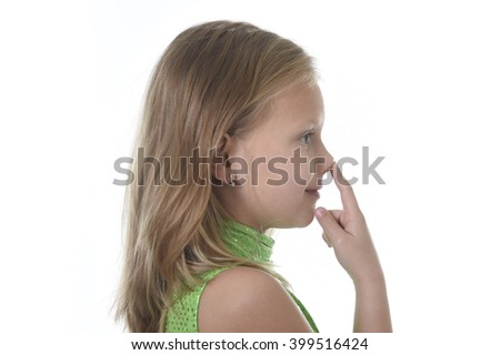 6 or 7 years old little girl with blond hair and blue eyes smiling happy posing isolated on white background pointing nose in language lesson for child education and body parts school chart set - stock photo