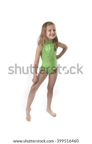 6 or 7 years old little girl with blond hair and blue eyes smiling happy posing isolated on white background pointing knee in language lesson for child education and body parts school chart set - stock photo