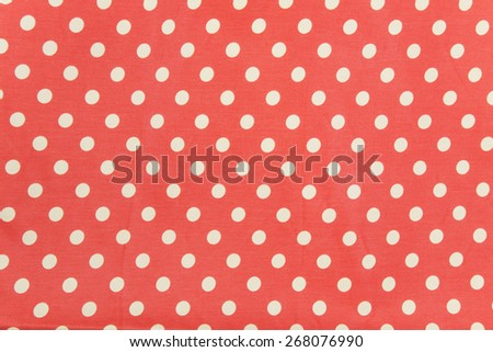 orange polka dot fabric background - stock photo