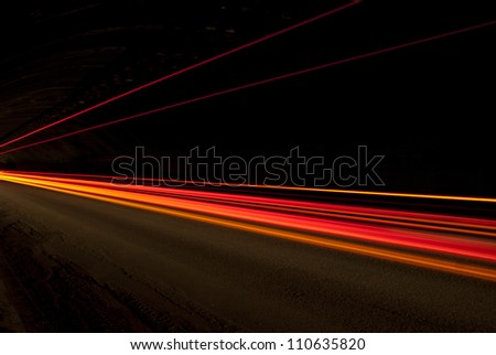 orange, red and yellow lights in road tunnel that can be used as background or texture - stock photo