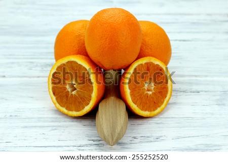 orange squeezer - stock photo