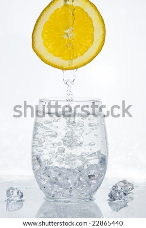 Orange with splashing water.  Healthy Eating.
