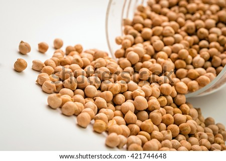 organic chickpeas food. uncooked chickpeas on white background