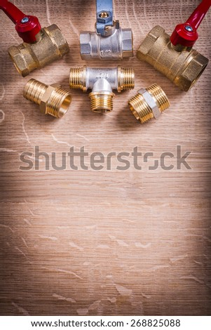 Organized Copyspace Aerial View Of Group Plumbing Items Brass Pipe Connectors On Wooden Board - stock photo