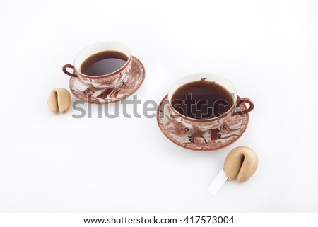 oriental cups of tea with fortune cookies