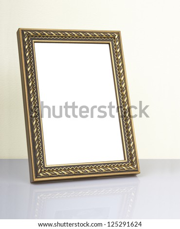Ornate vintage frame on the table - stock photo