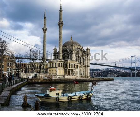 Ortakoy Mosque and Bosphorus bridge in Istanbul, Turkey - stock photo