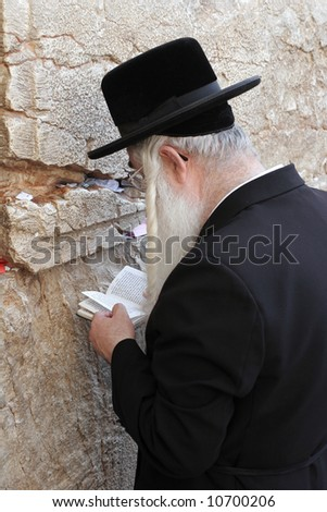 Orthodox prayer at the Western Wall in Jerusalem. - stock photo