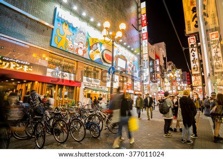 OSAKA,JAPAN- NOV 10:Night view of the neon advertisements Dotonbori on November 10, 2015 in Osaka, Japan.Is famous for its historic theatres,and restaurants, and its many neon and mechanised signs - stock photo