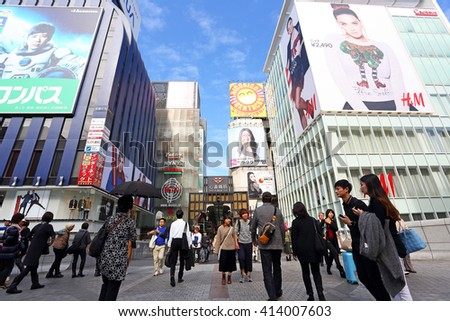 OSAKA, JAPAN - NOV 6: Tourists visits at The Glico Man advertising billboard and other in Dontonbori, Namba area on November 6, 2015 in Osaka, Japan. Namba is primary tourist destination