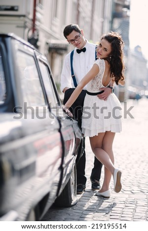 ��¡ouple by the old car. - stock photo