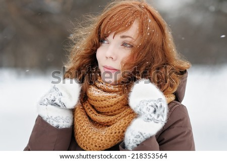 Outdoors portrait of young beautiful woman in winter