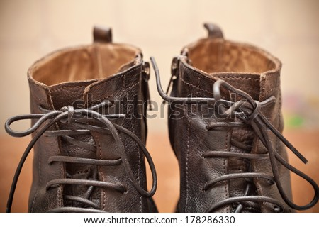 Pair of men's fashion shoes. Tying closeup. Autumn and spring shoes - stock photo