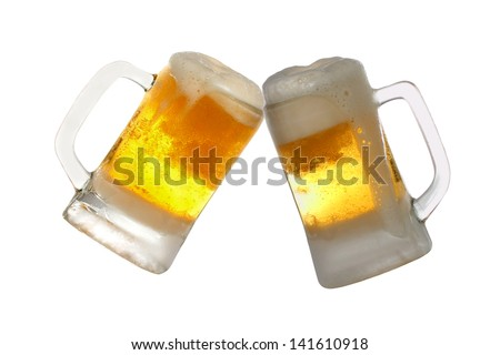 Pair of very cool beer glasses making a toast. Beer splash isolated on white background - stock photo