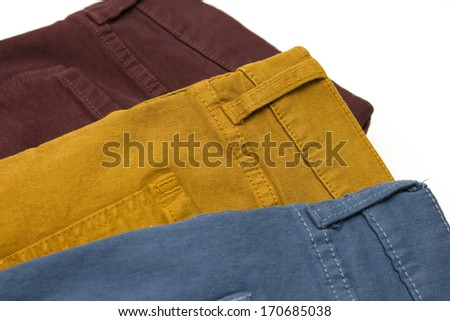 3 pairs of colourful jeans - stock photo