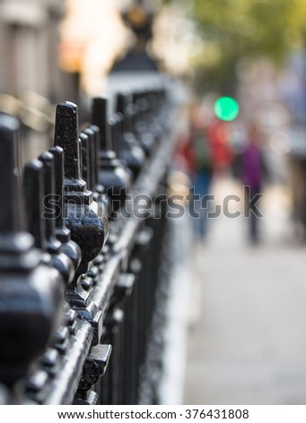 Pall Mall street decorative rail view blur with  walking people silhouettes - stock photo