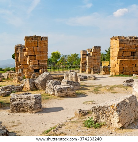 pamukkale    old       construction     in asia turkey the column  and the roman temple  - stock photo