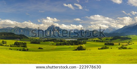 panorama landscape in Bavaria with alps mountains nearby city Fuessen - stock photo