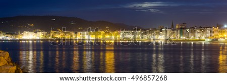 Panorama of La Concha Embankment  in  autumn night at Donistia. Basque Country, Spain