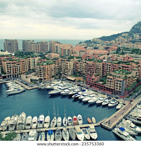 Panoramic landscape with harbor, lots of yachts in famous Monte Carlo, Cote d'Azur. square toned image - stock photo