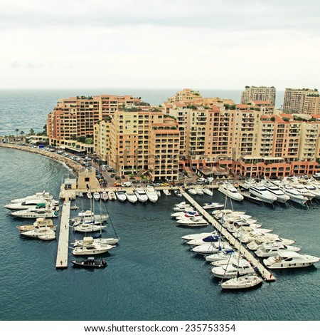 Panoramic landscape with harbor,pier and lots of yachts in famous Monte Carlo, Cote d'Azur. Square toned image - stock photo