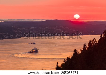 Panoramic view from hill of Bergen and fjord landscape red sky sunset scenery, Norway - stock photo