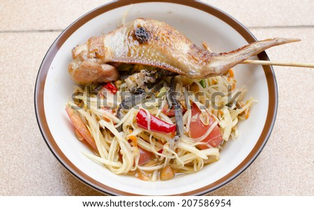 papaya salad with grilled Chicken - stock photo