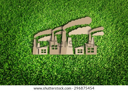 Paper cut of eco on green grass - stock photo